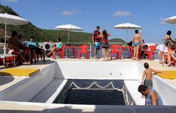 3 de Junho - Ppassageiros durante passeio de Catamarã - Piranhas (AL) - 130 Anos.