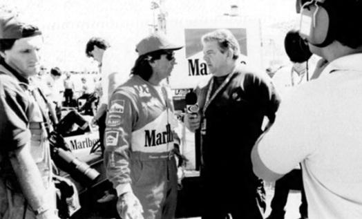 4 de Julho – Luciano do Valle durante entrevista com o piloto Emerson Fittipaldi na época de Indy.
