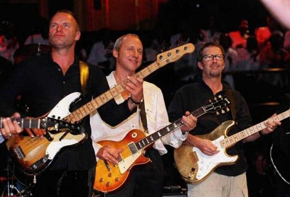 12 de Agosto – Mark Knopfler - 1949 – 68 Anos em 2017 - Acontecimentos do Dia - Foto 13 - Sting, Mark Knopfler e Eric Clapton, durante o 'Music For Montserrat', em Londres.