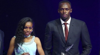 Usain Bolt of Jamaica (R) and Almaz Ayana of Ethiopia pose with their awards after being elected male and female World Athlete of the Year 2016 in Monaco.